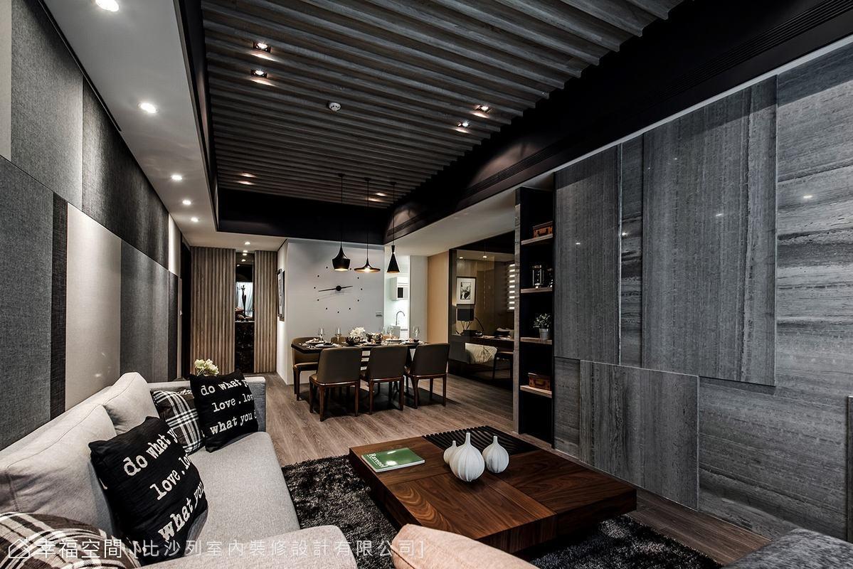 石材肌理採取縱橫拼接和方形堆疊,搭配局部開放的展示櫃體,簡練的造型中,比沙列設計同時闡述了前衛藝術與人文交融的居宅溫度。