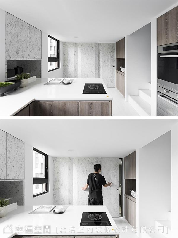 衛浴空間藏身在廚房對面,詹晧設計師以淺色木皮軌道門對應廚房的深色木皮系統櫃,宣示各自的獨立性。